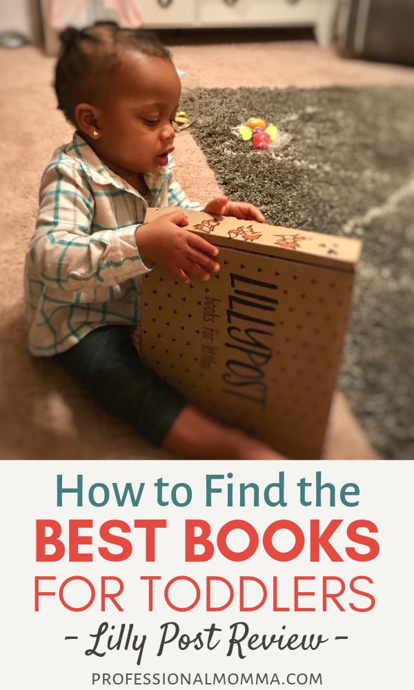 Toddler reading books from a subscription box