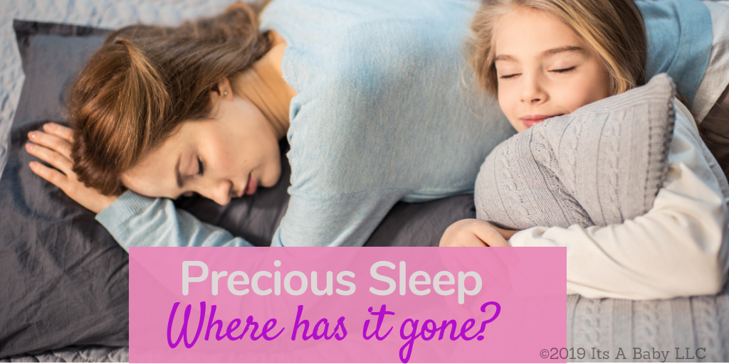 Mom enjoying precious sleep with her daughter