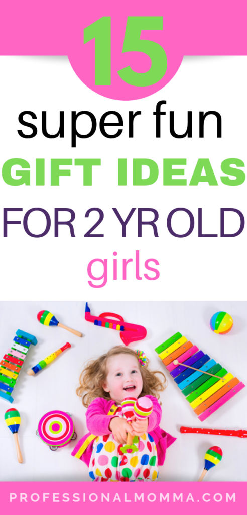 Gift ideas for 2 year old girls with little girl laying on the floor playing with toys.