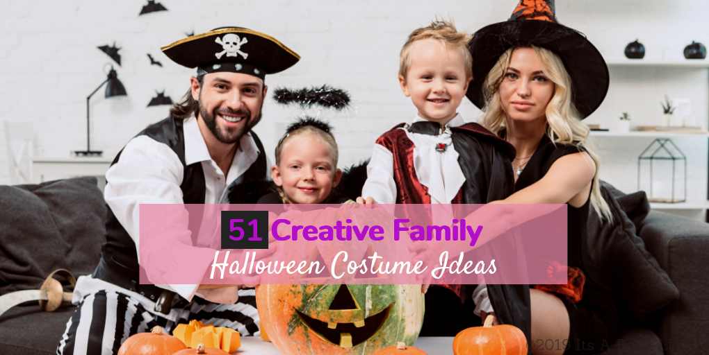 Family wearing family themed halloween costumes